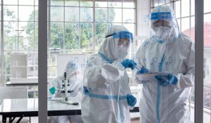 Scientists,And,Microbiologists,With,Ppe,Suit,And,Face,Mask,In
